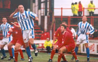 01011-10, Cullip is either cupping his ear to the quiet Orient fans or is jumping for a header